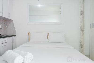 Homey and Comfortable Studio at Green Pramuka City Apartment By Travelio