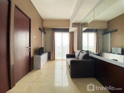 Comfy & Well Appointed 2BR at Tamansari Panoramic Apartment By Travelio