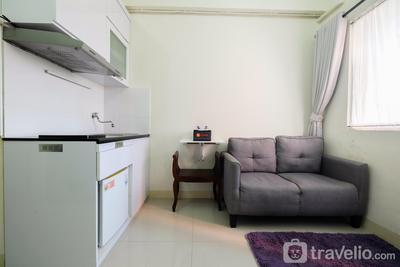 Tranquil 2BR @ Green Pramuka Apartment By Travelio