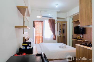 Studio near Shopping Mall at Green Pramuka City Apartment By Travelio