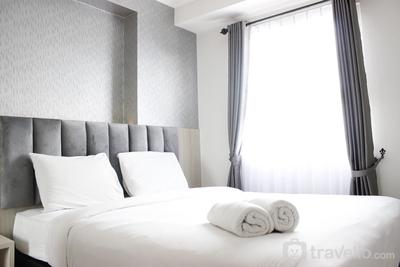 Bright & Stylish 2BR at Gateway Pasteur Apartment By Travelio