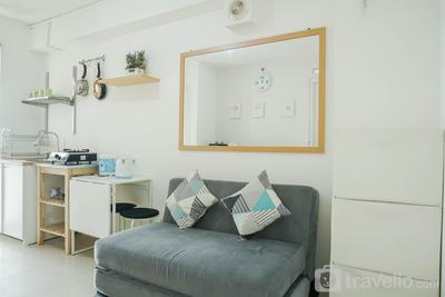 Fully Furnished and Cozy Design 2BR Bassura City Apartment By Travelio