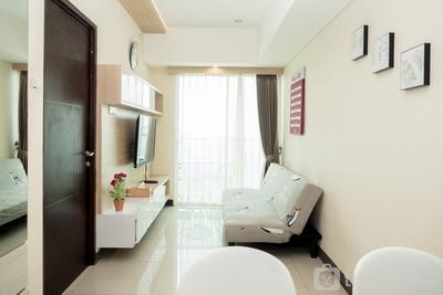 Best Location 2BR Tamansari La Grande Apartment By Travelio