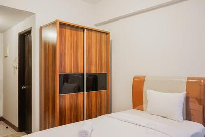 Comfy and Minimalist Studio Apartment Scientia Residence Tower B By Travelio