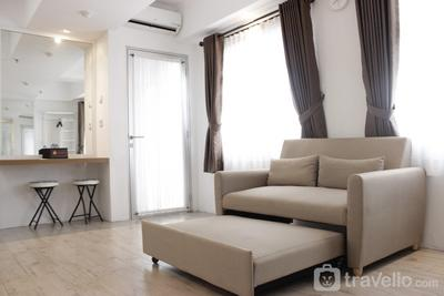 Modern Chic Studio Room at Grand Asia Afrika Apartment By Travelio