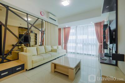 Modern 2BR Apartment with Pool View at Kemang Village By Travelio