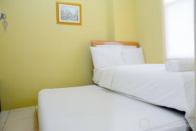 Comfy 2BR Green Bay Pluit Apartment By Travelio