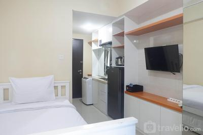 Cozy Studio Room Apartment at Tamansari Papilio By Travelio