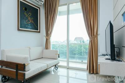 Minimalist and Comfy 1BR CitraLake Suites Apartment By Travelio