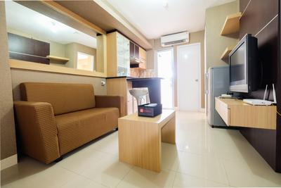 Homely 2 BR Bassura City Apartment By Travelio