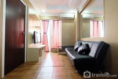 Relaxing 2BR with Pool View Mutiara Bekasi Apartment By Travelio