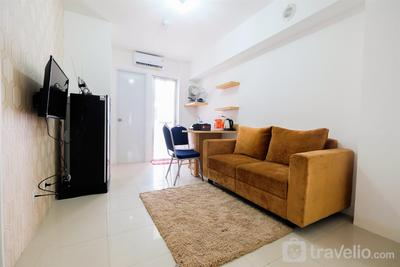 Cozy 2BR Bassura City Apartment with City View By Travelio