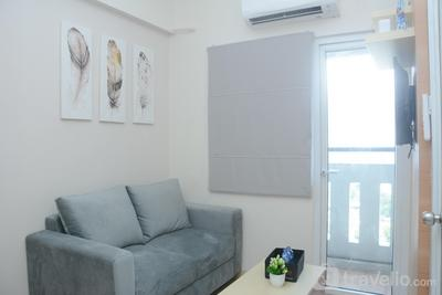 Cozy 2BR Green Pramuka with Great City View Apartment By Travelio