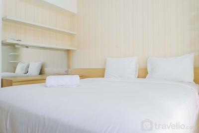 Cozy and Simple Studio at Educity Apartment Pakuwon City By Travelio