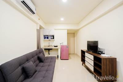 Homey and Cozy Living 1BR + Working Room at Meikarta Apartment By Travelio