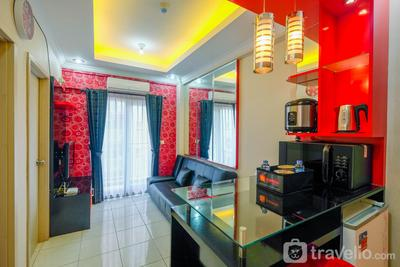 Comfy and Homey 2BR Grand Center Point Apartment By Travelio