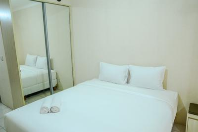 Minimalist Studio Room at Grand Serpong Apartment By Travelio