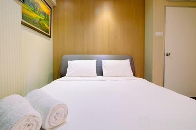 Homey 2BR at Green Bay Pluit Apartment near Mall By Travelio